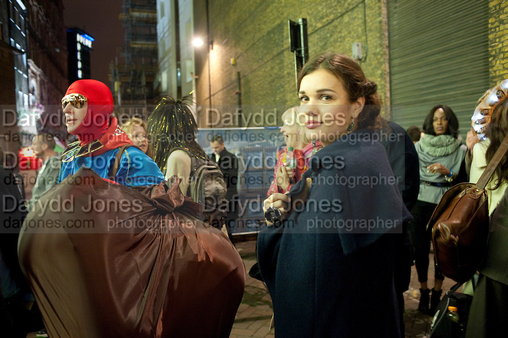 ANDRE BARTENEV; ANNA LEONOVA, Premiere of 'The British Guide to Showing Off' Jes Benstock's documantary on Andrew Logan's life and 12 Alternative Miss World's. Prince Charles cinema, Leicester Place. London and afterward's at Moonlighting, Greek St. London. 6 November 2011. <br /> <br />  , -DO NOT ARCHIVE-© Copyright Photograph by Dafydd Jones. 248 Clapham Rd. London SW9 0PZ. Tel 0207 820 0771. www.dafjones.com.