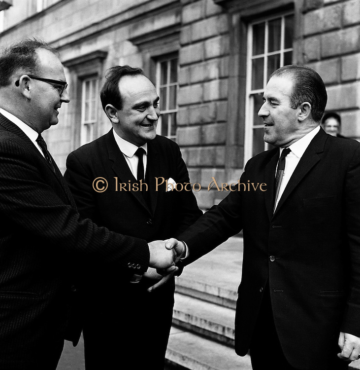 'All for One, and One for All'. New Dail Deputies Sean French (Cork) and Gerry Collins (Limerick) are welcomed to Leinster House by Neil Blaney TD..14.11.1967