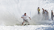 Warwick, New York - A skier wearing shorts and a t-shirt crosses the water during the annual Spring Rally at Mount Peter Ski and Ride on March 21, 2010.