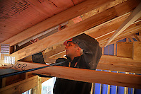 NC State volunteer works on the Build-A-Block Habitat for Humanity project.