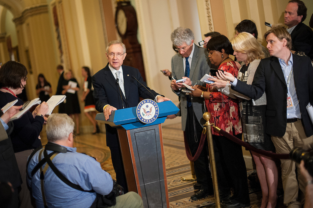 Senate Majority Leader Harry Reid (D-NV) speaks to reporters at a press conference on Capitol Hill Tuesday. Reid said that Republicans will have to accept higher taxes on the rich and leave Medicare alone if they want any chance of making a deal on reducing the debt.