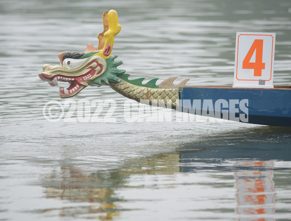 PDRAGON20P<br /> A dragon leads the way on a boat during the first annual Bucks County Dragon Boat Festival on Lake Luxembourg at Core Creek Park Saturday September 19, 2015 in Langhorne, Pennsylvania.  The purpose of the event is to Paddle Out Hunger with proceeds benefitting Bucks County Housing Group. (William Thomas Cain/For The Inquirer)