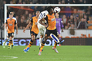 Hull City midfielder Moses Odubajo and Shinji Okazaki of Leicester City fight for the ball in the goal area during the Capital One Cup Fourth Round match between Hull City and Leicester City at the KC Stadium, Kingston upon Hull, England on 27 October 2015. Photo by Ian Lyall.