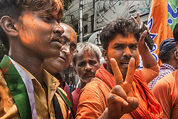 May 23, 2019, Kolkata, India: Supporters of Bharatiya Janata Party (BJP) celebrate in Kolkata, India. Latest trends from all constituencies that went to polls in India's general elections showed that the ruling Bharatiya Janata Party (BJP) seems to win in around 292 constituencies on its own, according to the Election Commission of India (ECI) on Thursday. (Credit Image: © Xinhua via ZUMA Wire)