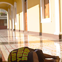 A homeless man lies asleep. Granada is Nicaragua's most famous city. founded in 1524 it is one of best examples of Spanish colonial architecture in the Americas. .it has a varied history including its almost total destruction by filibuster William Walker in a childlike tantrum. Today it is a popular tourist town though retains a strong sense of its own identity.