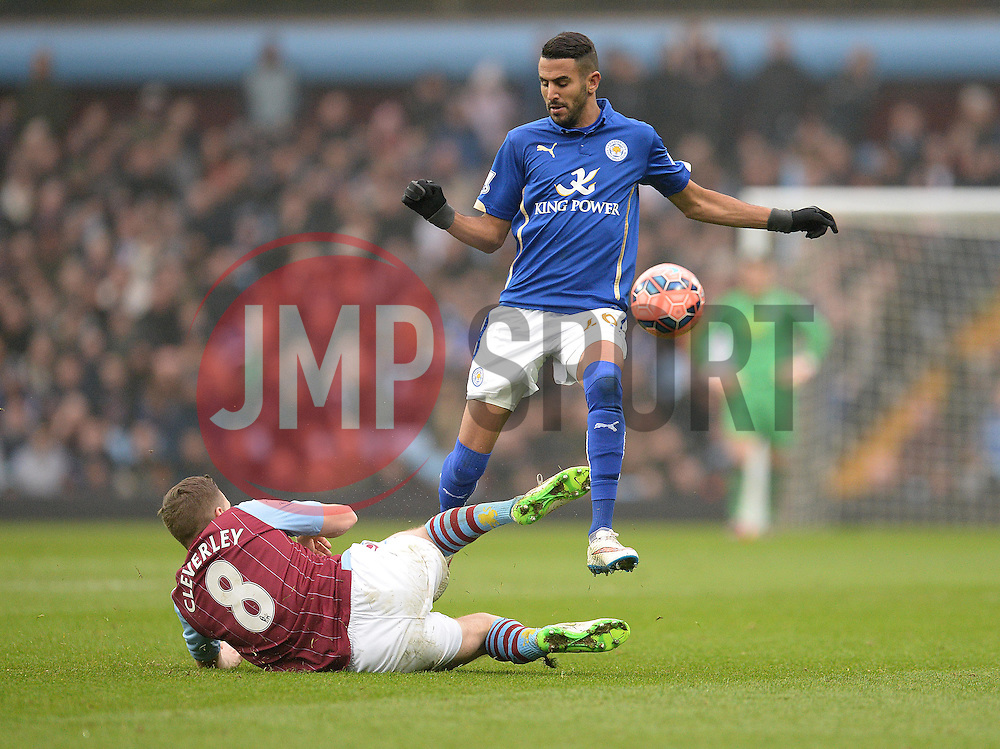 Aston Villas Tom Cleverley tackles Leicester City's Andy King - Photo mandatory by-line: Alex James/JMP - Mobile: 07966 386802 - 15/02/2015 - SPORT - Football - Birmingham - Villa Park - Aston Villa v Leicester City - FA Cup - Fifth Round