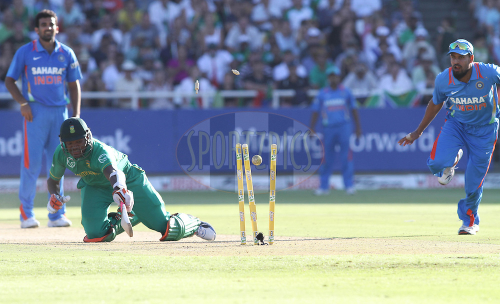 Lonwabo Tsotsobe of South Africa is run out by Yusuf Pathan of India during the 3nd ODI between South Africa and India held at Sahara Park Newlands Stadium in Cape Town, Western Cape, South Africa on the 18th January 2011..Photo by Shaun Roy/BCCI/Sportzpics