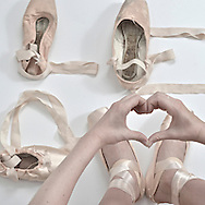 Love written with pointe ballet shoes.   ( Kike Calvo via AP Images )