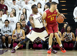 Iowa State's Georges Niang (31) tries to backdown Texas A&M's Jalen Jones (12) during the first half of an NCAA college basketball game, Saturday, Jan. 30, 2016, in College Station, Texas. Texas A&M won 72-62. (AP Photo/Sam Craft)