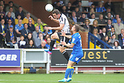 Harrison McGahey wins a header during the EFL Sky Bet League 1 match between AFC Wimbledon and Rochdale at the Cherry Red Records Stadium, Kingston, England on 30 September 2017. Photo by Daniel Youngs.