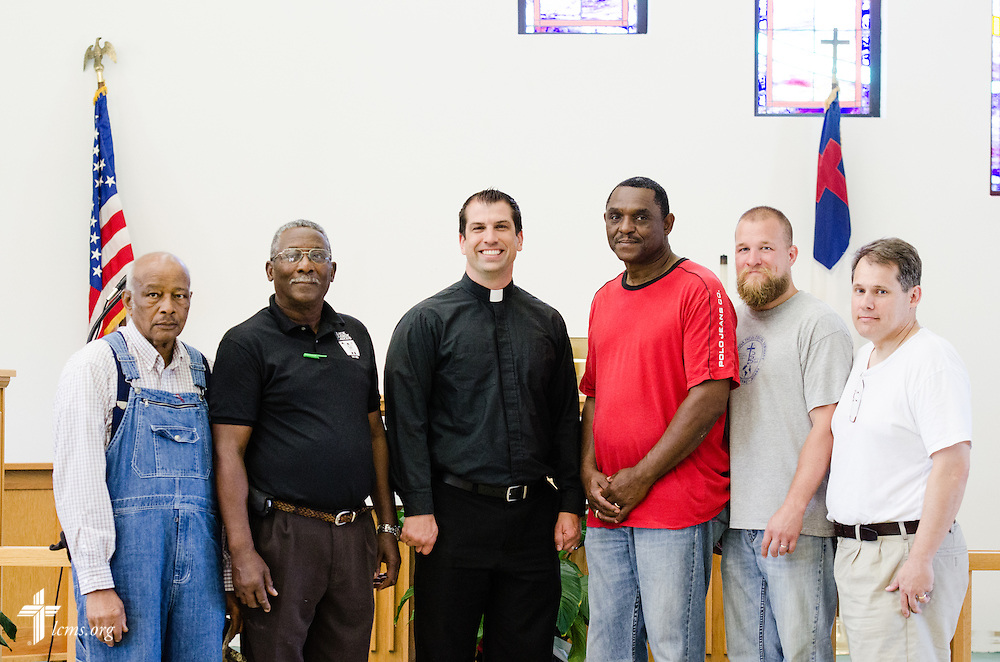 The Rev. Ross Johnson, director of LCMS Disaster Response (center), is surrounded by local pastors at St. Matthew Lutheran Church in Pensacola, Fla., on Saturday, May 3, 2014. LCMS Communications/Erik M. Lunsford