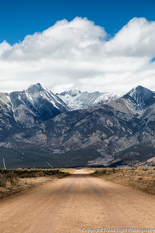 No easy roads to the top of Mt Blanca, pictured center beneath the clouds.  Picture taken headed south out of Blanca, CO.