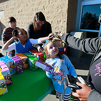 Thomas Wells | BUY at PHOTOS.DJOURNAL.COM<br /> Lucy Robertson, center, 5, watches as Jazzlyn Williams, right, hands over her money to Chrislynn Senter, 6, of troop 20376 for a box of Girl Scout Cookies on Friday at the West Main Wal-Mart.