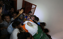 October 3, 2018 - Maghazi, Gaza Strip, Palestinian Territory - Mourners carry the body of an elderly Palestinian Ibrahim al-Arrouqi, 78, who was shot dead by Israeli forces during his funeral in al-Maghazi in the center of the Gaza Strip on October 3, 2018  (Credit Image: © Ashraf Amra/APA Images via ZUMA Wire)