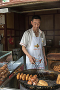 Chinese Street food. Food vendor sells food at a stall in  Sichuan, China