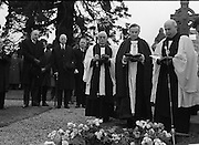 The State Funeral of Sir Alfred Chester Beatty at Glasnevin Cemetery, Dublin. The Archbishop of Dublin, The Most Rev. G.O. Simms prays over the grave. Onlookers include President Eamon de Valera and the Lord Mayor of Dublin, Councillor T. Stafford..29.01.1968