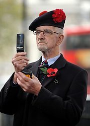 © Licensed to London News Pictures. 10/11/2011. London, UK. A veteran films HRH Duke of Edingburgh on his mobile phone. HRH The duke of Edinburgh opens the annual Field of Remembrance at Westminster Abbey today 10 November. . Photo credit : Stephen Simpson/LNP