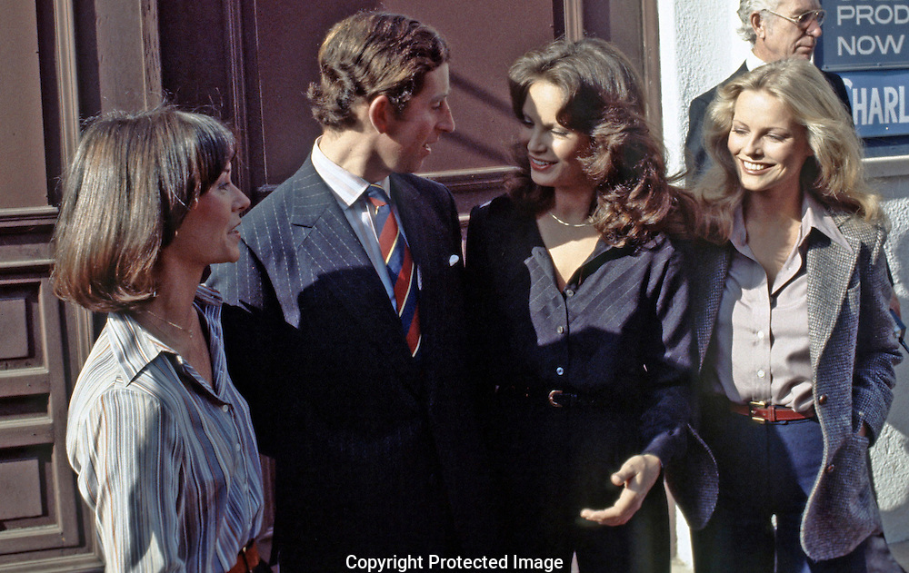Prince Charles with Charlie's Angels  in Los Angeles California in October  1977..Photograph by Dennis Brack bs b 17