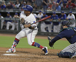 September 12, 2017 - Arlington, TX, USA - The Texas Rangers' Willie Calhoun gets his first major league hit and RBI during the second inning against the Seattle Mariners at Globe Life Park in Arlington, Texas, on Tuesday, Sept. 12, 2017. (Credit Image: © Max Faulkner/TNS via ZUMA Wire)