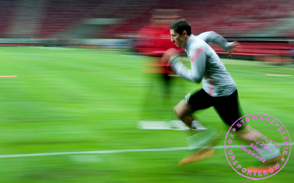 Robert Lewandowski of Poland runs during the training session one day before friendly soccer match between Poalnd and South Africa at National Stadium in Warsaw on October 11, 2012...Poland, Warsaw, October 11, 2012..Picture also available in RAW (NEF) or TIFF format on special request...For editorial use only. Any commercial or promotional use requires permission...Photo by © Adam Nurkiewicz / Mediasport