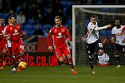 MK Dons forward Dean Bowditch  tries to get away from Bolton Wanderers forward, on loan from Arsenal, Alves Wellington Silva  during the Sky Bet Championship match between Bolton Wanderers and Milton Keynes Dons at the Macron Stadium, Bolton, England on 23 January 2016. Photo by Simon Davies.