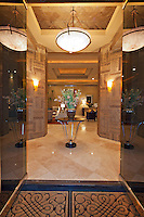 Glass doors open to luxurious foyer