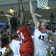 United States Center Jantel Lavender (24) drives to the basket as United States Center Breanna Stewart (43) blocks Lavender shot under the basket in the first half of a USA Women's National Team Exhibition game between Red and White Thursday, Sept. 11, 2014 at The Bob Carpenter Sports Convocation Center in Newark, DEL