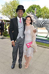 Cricketr MICHAEL HOLDING and his wife LAURIE ANN HOLDING at the Investec Derby 2015 at Epsom Racecourse, Epsom, Surrey on 6th June 2015.