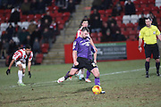 Padraig Amond scores Morecambes equaliser from the penalty spot during the Sky Bet League 2 match between Cheltenham Town and Morecambe at Whaddon Road, Cheltenham, England on 16 January 2015. Photo by Shane Healey.