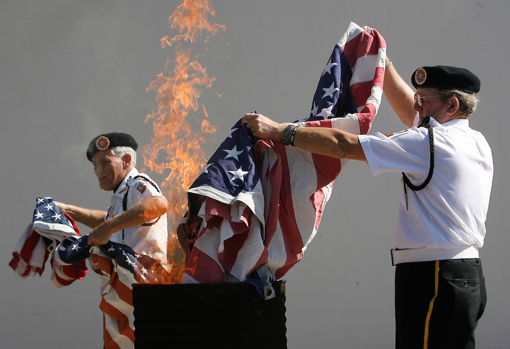 PT_297323_FITT_pasvet_2.(Holiday 11/11/2008).BRENDAN FITTERER | Times.Robert Farrell, right, and Fred Faulkner, both of the VFW Post 10167 Honor Guard, burn old, damaged flags for proper disposal outside the Post on Bartelt Road in Holiday following Tuesday's annual Veterans Day Ceremony..SUMMARY:. Veterans Day ceremony. VFW Post 10167 will hold its Veterans Day ceremony at 11 a.m. Tuesday at 4619 Bartelt Road, Holiday, (727) 938-5977. The public is welcome to bring old, damaged flags for proper disposal.