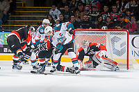 KELOWNA, CANADA - JANUARY 10: Marek Langhamer #30 of Medicine Hat Tigers watches the puck as Madison Bowey #4 of Kelowna Rockets digs on January 10, 2015 at Prospera Place in Kelowna, British Columbia, Canada.  (Photo by Marissa Baecker/Shoot the Breeze)  *** Local Caption *** Marek Langhamer; Madison Bowey;