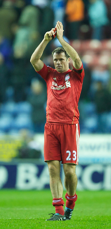 WIGAN, ENGLAND - Wednesday, November 10, 2010: Liverpool's Jamie Carragher applauds his side's travelling supporters after a poor 1-1 draw with Wigan Athletic during the Premiership match at the DW Stadium. (Photo by David Rawcliffe/Propaganda)