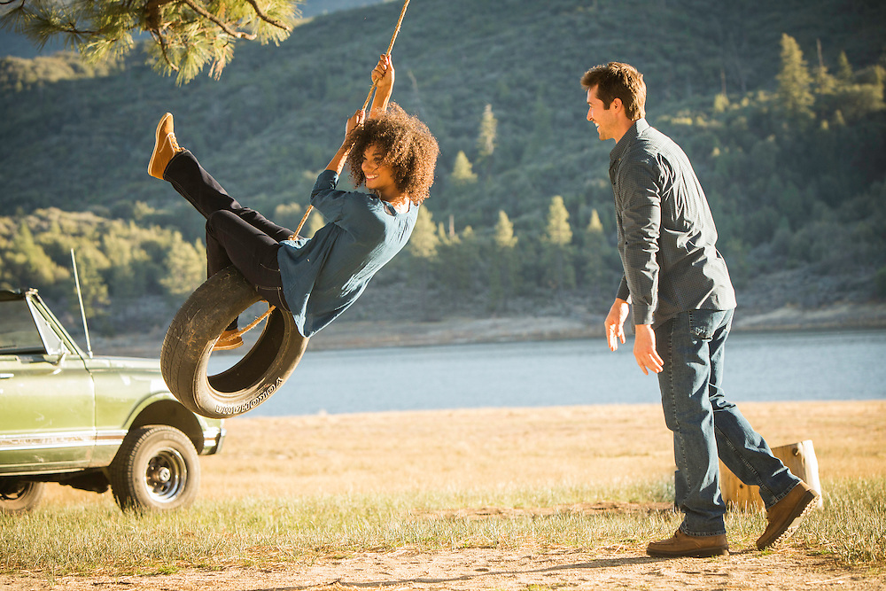 Hemet Lake Park,CA for Wrangler advertising of a couple swinging on an old tire with truck and lake in the background