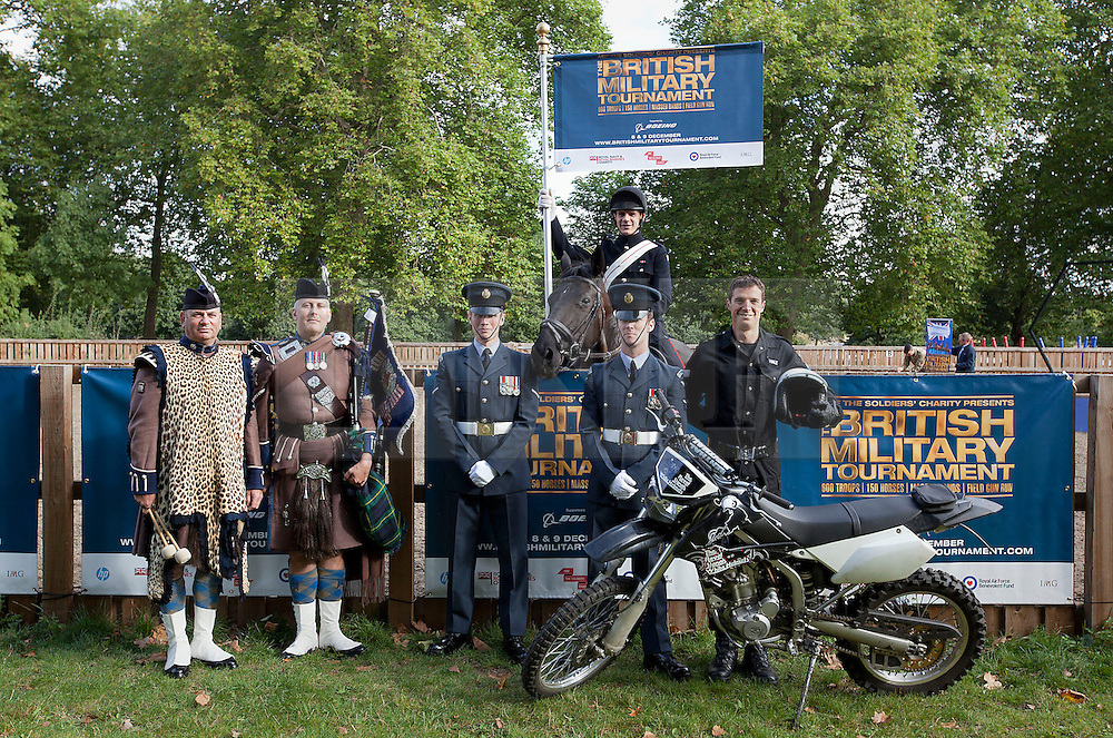© Licensed to London News Pictures. 12/09/2012. LONDON, UK. Members of the British Army and Royal Air Force pose for a group shot in Hyde Park London today (12/09/12) after a taster of some of the acts taking part in the 2012 British Military Tournament. The theme of this year's tournament, involving all arms of the British military, is the life and times of Her Majesty the Queen and takes place at Earls Court in London on the 8th and 9th of December. Photo credit: Matt Cetti-Roberts/LNP