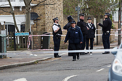 © Licensed to London News Pictures. 04/04/2016. London, UK. Police officers at the cordon in Camplin Street, New Cross, Lewisham, where a 17 year old boy died last night after being fatally stabbed. Police have arrested two teens in connection with the murder. Photo credit : Vickie Flores/LNP