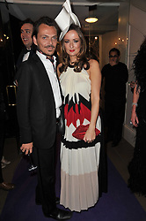 MATTHEW WILLIAMSON and LUCY YEOMANS at The Surrealist Ball in aid of the NSPCC in association with Harpers Bazaar magazine held at the Banqueting House, Whitehall, London on 17th March 2011.