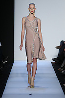 A model walks the runway wearing Hervé Leger Fall 2014 in New York on February 7th, 2014