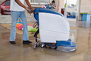Man operates a floor sweeper vacuum machine