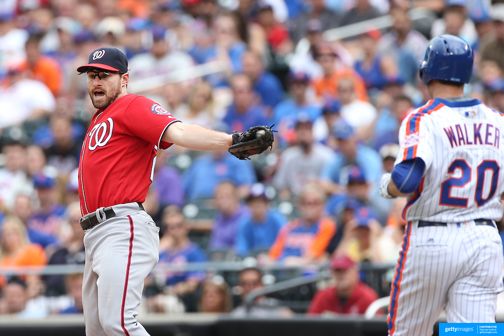 NEW YORK, NEW YORK - July 10: Daniel Murphy #20 of the Washington Nationals catches the throw to first base to get the out of Neil Walker #20 of the New York Mets during the Washington Nationals Vs New York Mets regular season MLB game at Citi Field on July 10, 2016 in New York City. (Photo by Tim Clayton/Corbis via Getty Images)