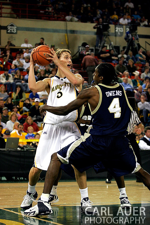 25 November 2005: Golden Eagle Dan Fitzgerald (5) looks to make a pass as ORU's Larry Owens (4) plays tight defense in the Marquette University 73-70 victory over Oral Roberts University at the Great Alaska Shootout in Anchorage, Alaska