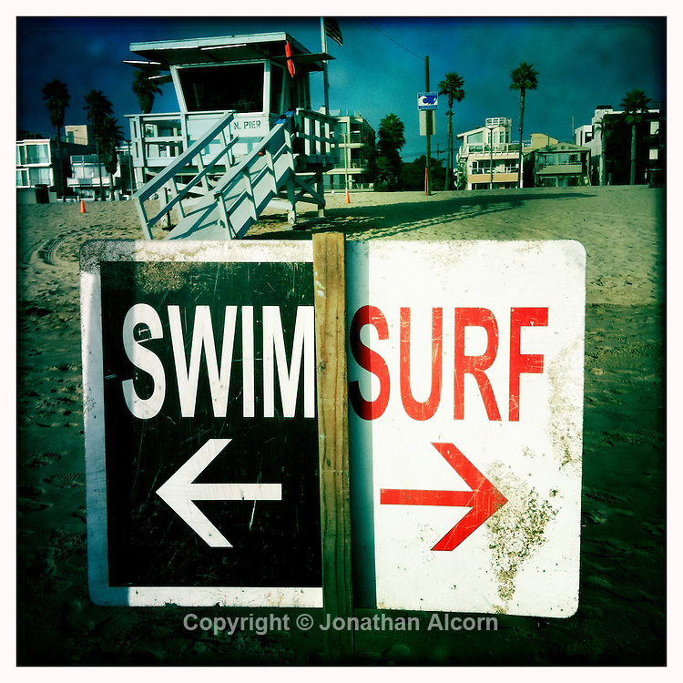 Swim Surf sign with Lifeguard tower on  Venice Beach