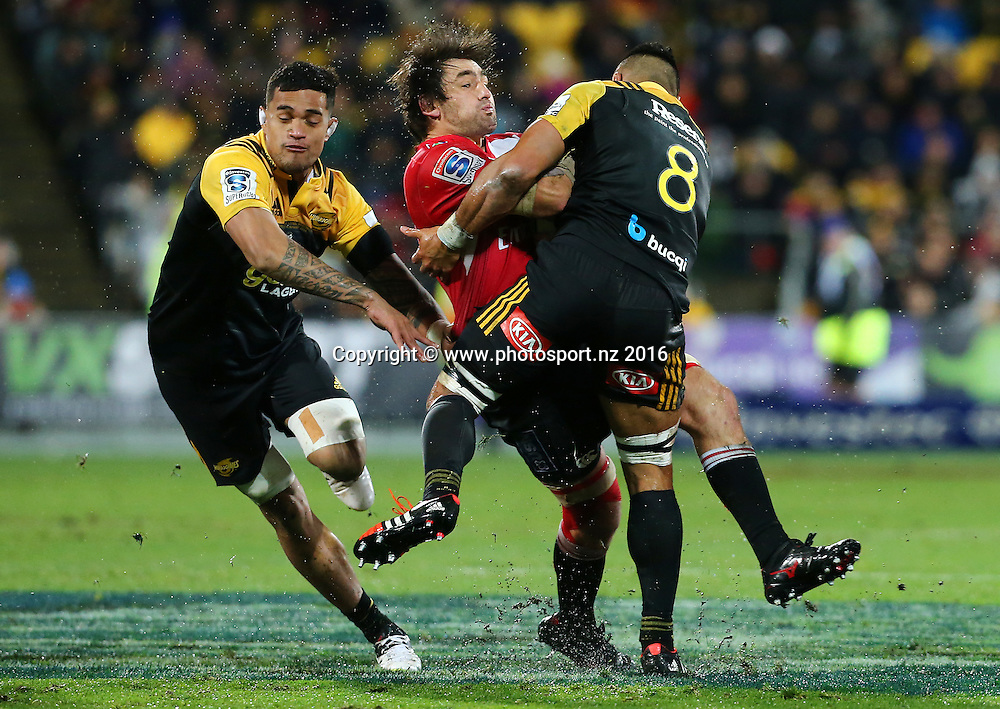 Lions' Warwick Tecklenburg is hit in a tackle by Hurricanes' Victor Vito during the Investec Super Rugby Final. Hurricanes v Lions at Westpac Stadium, Wellington, New Zealand. 6th August 2016. © Copyright Photo: Grant Down / www.photosport.nz
