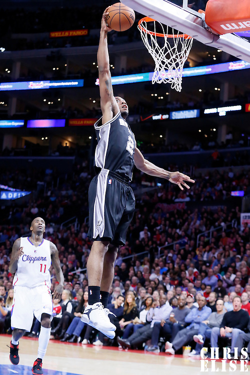 10 November 2014: San Antonio Spurs forward Kawhi Leonard (2) goes for the dunk during the San Antonio Spurs 89-85 victory over the Los Angeles Clippers, at the Staples Center, Los Angeles, California, USA.