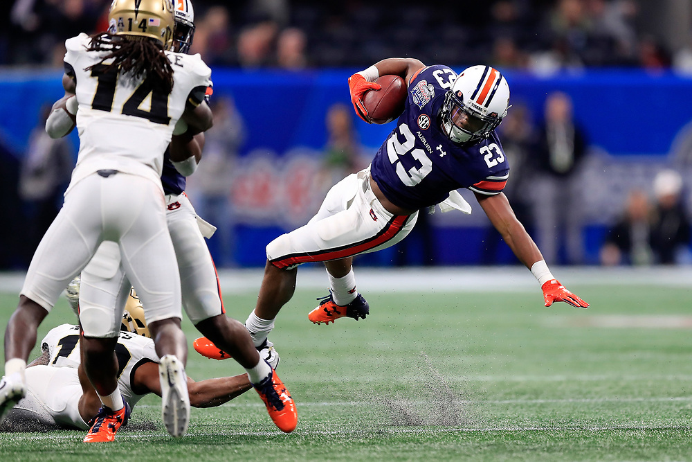 Auburn Tigers wide receiver Ryan Davis (23) runs the ball during the 2018 Chick-fil-A Peach Bowl NCAA football game against the UCF Knights on Monday, January 1, 2018 in Atlanta. (Paul Abell / Abell Images for the Chick-fil-A Peach Bowl)