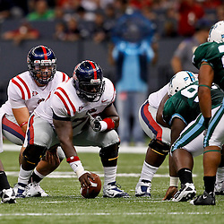 Sep 11, 2010; New Orleans, LA, USA; Mississippi Rebels quarterback Jeremiah Masoli (8) lines up for a play against the Tulane Green Wave during the first half at the Louisiana Superdome.  Mandatory Credit: Derick E. Hingle