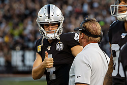OAKLAND, CA - NOVEMBER 17: Quarterback Derek Carr #4 of the Oakland Raiders talks to head coach Jon Gruden on the sidelines during the fourth quarter against the Cincinnati Bengals at RingCentral Coliseum on November 17, 2019 in Oakland, California. The Oakland Raiders defeated the Cincinnati Bengals 17-10. (Photo by Jason O. Watson/Getty Images) *** Local Caption *** Derek Carr; Jon Gruden