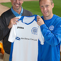 Gordon Bannerman with St Johnstone's Steven Anderson pictured at McDiarmid Park with the strip that will be worn for his testimonial game against Hearts on Sunday...30.07.14<br /> Picture by Graeme Hart.<br /> Copyright Perthshire Picture Agency<br /> Tel: 01738 623350  Mobile: 07990 594431