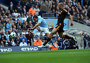 Carlos Tevez takes a shot on goal during the Barclays Premier League match between Manchester City and Chelsea at the City of Manchester Stadium on September 25, 2010 in Manchester, England.