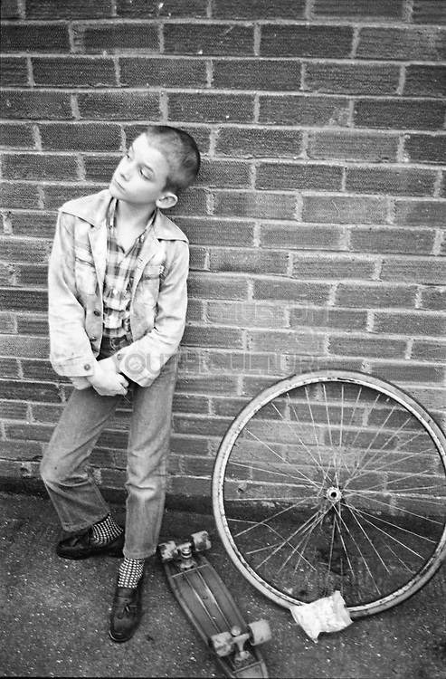 Neville with skateboard and bike wheel, Hawthorne Road, High Wycombe, UK, 1980's