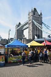 Food stalls by Tower Bridge near St Katherine's Dock, London UK